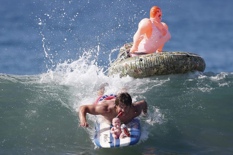 <label>Description: </label><span>John Broz, 28, rides a wave in a costume entitled 'The redneck yacht club' during the 7th annual ZJ Boarding House Haunted Heats Halloween surf contest in Santa Monica, California.</span>